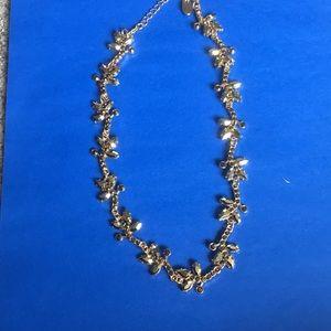 Golden statement necklace or headband.